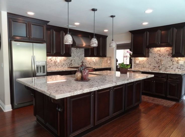 Alaska White Granite Dark Cabinets With Pendants Lights I