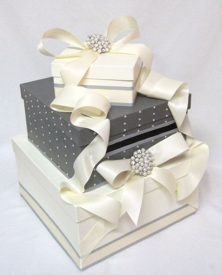 Coming up with ideas for a card box for my wedding.  Wedding colors are black, white, and grey.