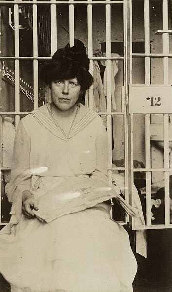 """Lucy Burns was an American suffragist. After protesting in D.C., she was arrested and sent to a workhouse. To break their spirits, the jailers began what has become known as the """"Night of Terror."""" Lucy Burns was beaten and handcuffed to her cell door with her hands above her head and left that way for the entire night. Of all the American Suffragists, Lucy Burns spent the most time in jail. Here's to our right to vote!"""