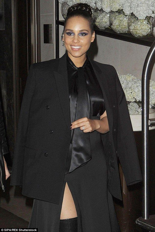 In great shape: She gave a slight flash of her legs as she added height to the look with black knee-high boots