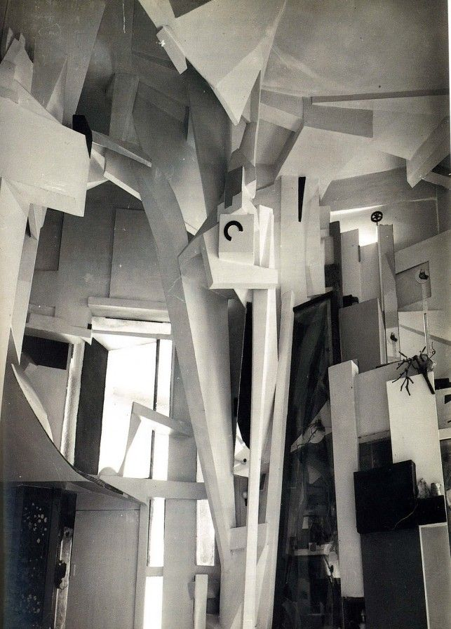 Kurt Schwitters, Dada Künstler - Merzbau in Hannover, Germany. Photo by Wilhelm Redemann, 1933. Schwitters worked on the Hanover Merzbau from around 1923 until 1937, when he fled to Norway to escape the threat of Nazi Germany. Sadly, in 1943, while he was in exile, it was destroyed in an Allied bombing raid. This original Merzbau was gone forever.