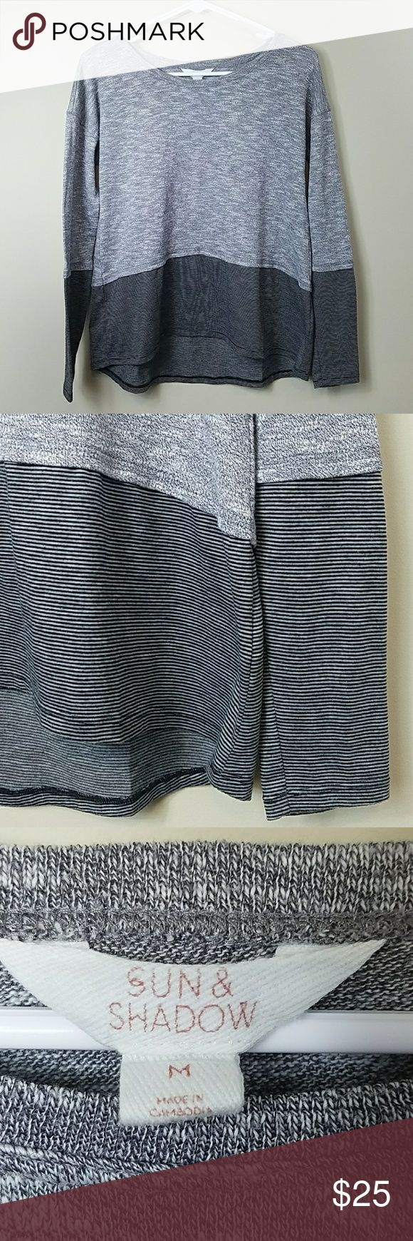 """Nordstrom Sun & Shadow Layered Look Top Nordstrom Sun & Shadow Layered Look Top.   Size medium.  Heathered gray upper with gray & black striped fabric on lower part and sleeves.  Super cute athleisure top! 60% cotton, 40% polyester. 19"""" across the bust.  22.5"""" front length.  25.5"""" back length. Sun & Shadow Tops"""