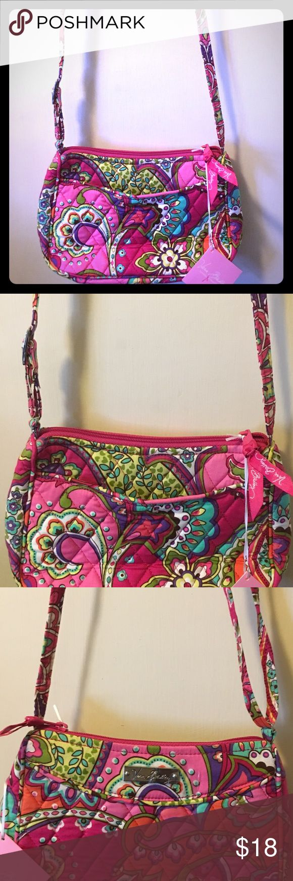 Vera Bradley Mini Crossover Bag This cute crossbody is sized just right for all the essentials. The back slip pocket is the ideal place for keys and a phone, while the zip-top closure keeps other everyday must-haves secure. Features a back slip pocket. Zip closure. Pet Free/Smoke Free Home Vera Bradley Bags Crossbody Bags