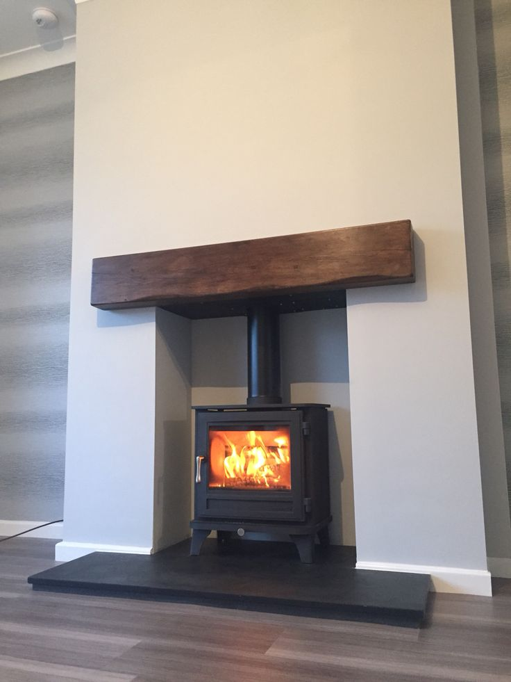 Chesney Salisbury 5 stove with a Beazilian Slate hearth and a Bespoke solid oak beam