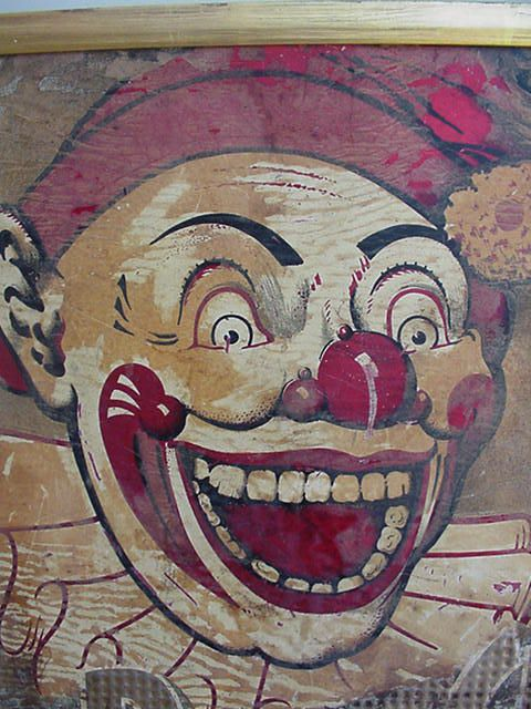 """Tin sign. The iconic clown from Ponchartrain Beach Amusement Park in New Orleans.  Said to be the """"defining scary clown"""" on scary clown spectrum, according to research psychologists at Tulane University."""