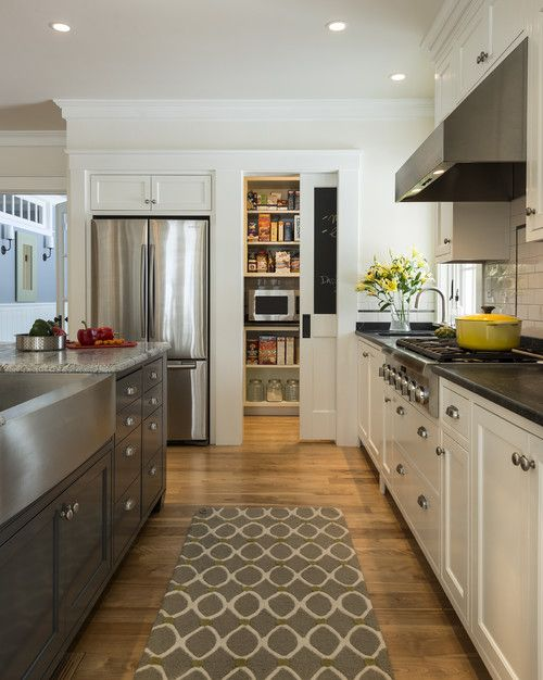 perfect idea for kitchen makeover. love the mismatch of the light and dark cabinets, and the pocket door
