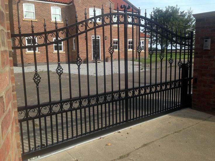 Wrought iron sliding gate, galvanised and powder coated. Manufactured, installed and automated by Swan Gates. www.swangates.com