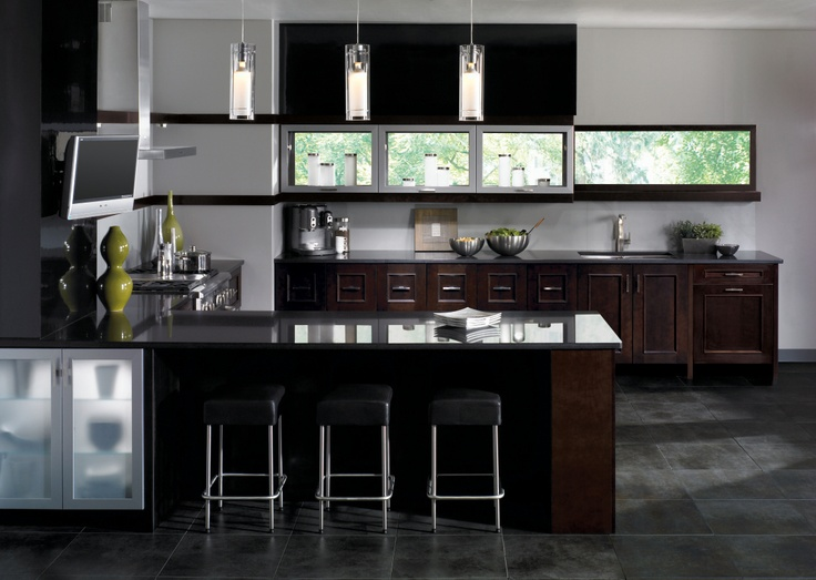 Contemporary Kitchen Cabinets In Maple Take The Dark Espresso Finish Beautifully While Stainless Steel Liances Focused Lighting Deep Stone And