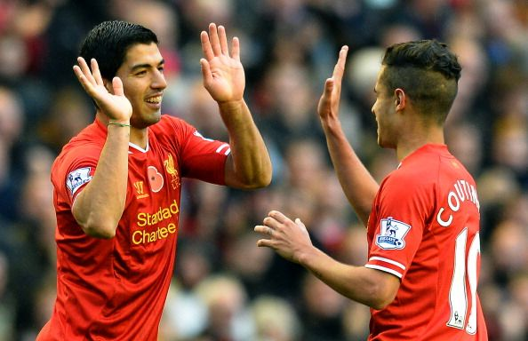 Liverpool's Uruguayan striker Luis Suarez (L) celebrates scoring a goal with teammate Brazilian midfielder Philippe Coutinho during the English Premier League football match between Liverpool and Fulham at Anfield in Liverpool, northwest England on November 9, 2013