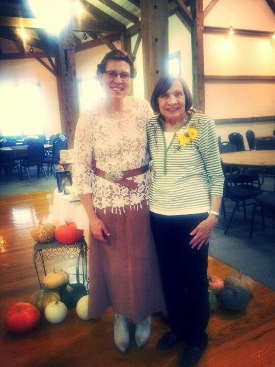 The bride and her mother at a rustic/western barn reception