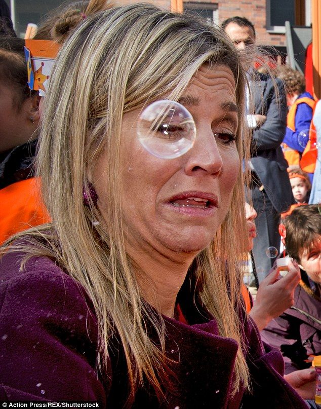 Fear: Queen Maxima couldn't pulled a panicked expression as she sheepishly shied away from approaching bubbles