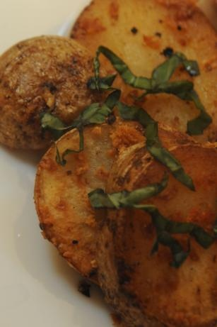 """Potatoes With Basil (Argentina) from Food.com:   This recipe is from week 12 of my food blog, """"Travel by Stove."""" I am attempting to cook one meal from every nation on Earth, and Argentina is my 12th stop. This simple roast potato recipe is made with butter, and the basil adds a unique twist."""