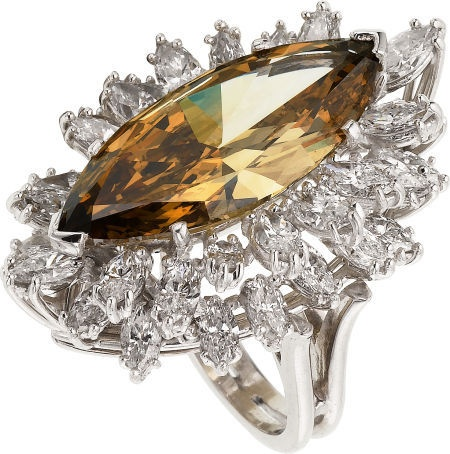 Regal marquise-cut cognac diamond in a double halo setting of marquise white diamond accents....