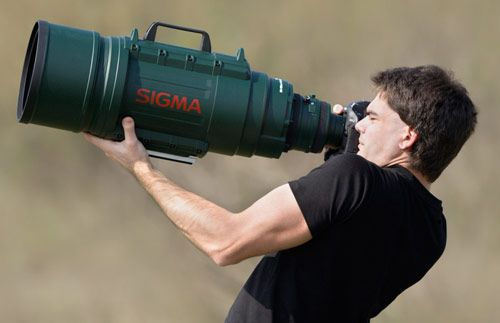 sigma-telephoto: – the world's largest consumer lenses.   Sigma 200-500mm f2.8 APO EX DG Telephoto Zoom    Weighing in at a hefty 34.6lbs and 726mm in length, this is not the easiest lens to carry around with you on holiday.  As well as being meaty, the Sigma 200-500mm also wins some world firsts; it is the first large-aperture ultra telephoto lens to have an f/2.8 aperture at 500mm, and is the largest high-speed zoom lens available.  $ 32,000