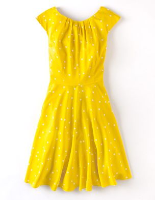 Flowershow Dress from Boden. The yellow is so happy and I love the polka dots!