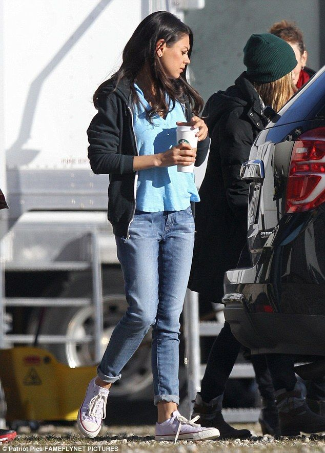 Quick change: Mila later was seen wearing a hoodie and light jeans rolled up over white Converse sneakers