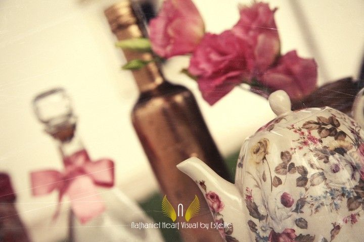 Vintage bottles and ceramic teapot together create the perfect wedding decorations.  by Michela & Michela www.italianweddingcompany.com