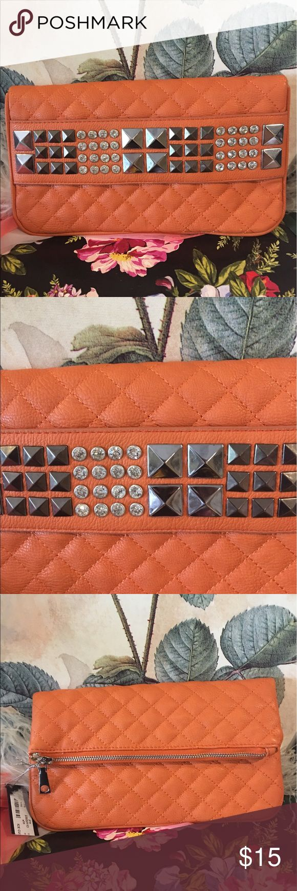 "Ice Cube Faux Orange Leather clutch Handbag NWT Ice Cube brand Faux leather orange clutch bag. Embellished with rhinestones and studs. It has snap closure but also opens up fully and has zipper closure as shown in photos. Measures 11"" across x 10"" tall unfolded and 10"" x 6 1/2"" folded and snapped. NWT. Ice Cube Bags Clutches & Wristlets"
