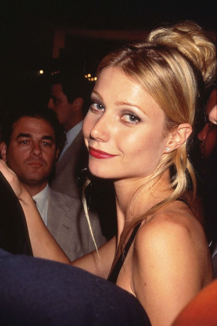 Emma Premiere, 1996Here lies the picture that started our internet spiral. Like some kind of modern Bardot, we've puzzled for at least 45 minutes over how she's tied her hair with that ribbon (Cloth? Tie? Scarf?). When we find out, we'll let you know.  #refinery29 http://www.refinery29.com/2016/03/106619/gwyneth-paltrow-lookbook-throwback-90s-fashion#slide-15