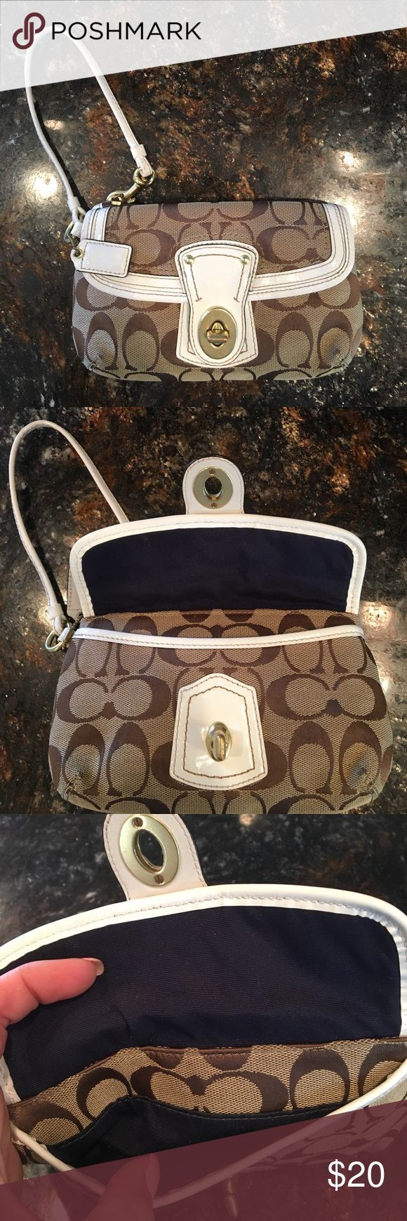 Coach Wristlet Hardly used tan, white and navy Coach wristlet. Front flap opens and has room to hold a cell phone. Back zipper has enough room for cards, cash, chap stick etc. Coach Bags Clutches & Wristlets