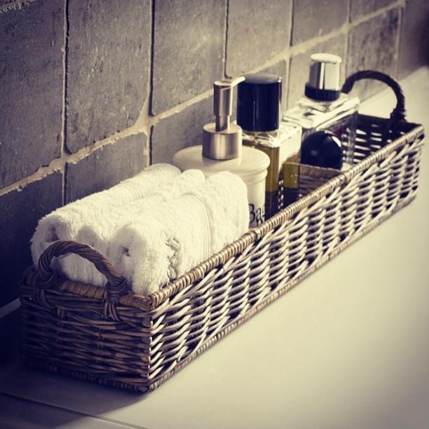 Basket to clean up bathroom counter master bedroom ideas for Bathroom basket ideas