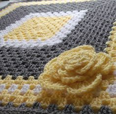 Yellow and gray crocheted granny square baby blanket