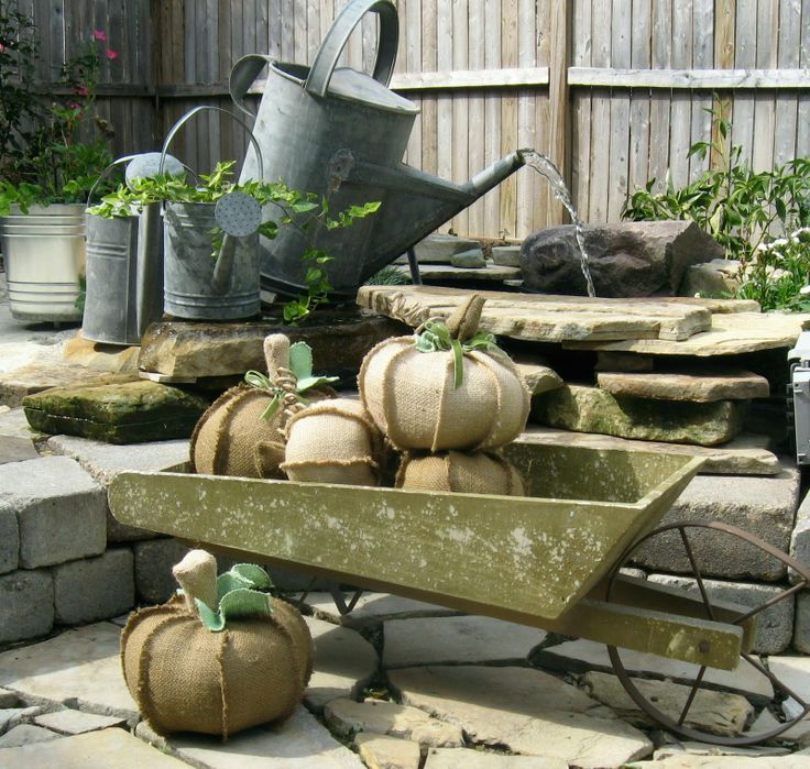 I don't know which is cuter ~ the watering can fountain or the burlap pumpkins! ~