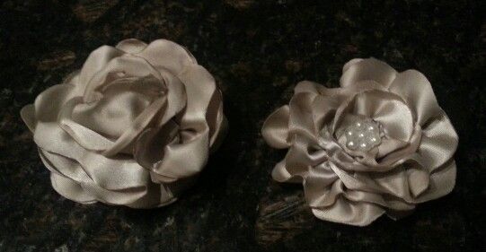 Flowers made from ribbon.   I think I can do better..