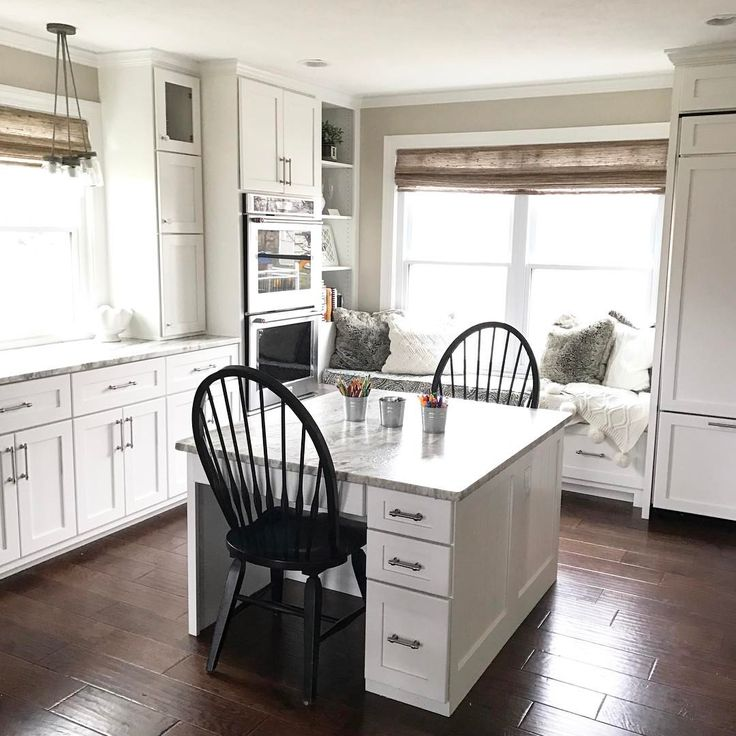 The built-in desks that I designed for our boys also serve as a second island and baking station in our new kitchen! It's one of our favorite features and the boys spend a lot of time here! 💙💙 #neutraldecor #homedecor #homestyle #mybhg #whitekitchen #whitekitchenlove #hgtv #kitchendesign #kitcheninspo #kitchendecor #kitchenremodel #windsorchair #ourcomfyhome #interiordesign #interior