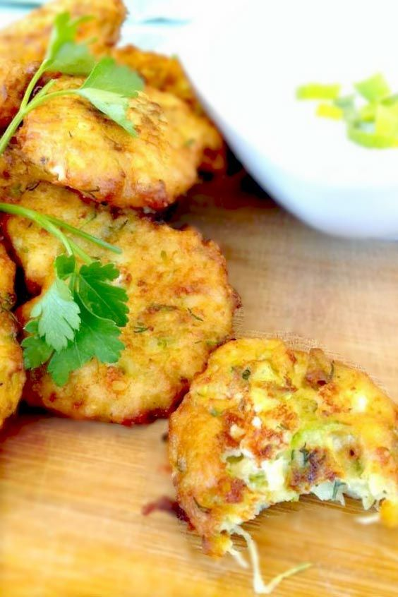 These Greek zucchini fritters are ready in just 5 minutes. Made with feta cheese and served with a refreshing Greek yogurt dip. A must-try. #Greek,#Zucchini,#Recipe,#fritters,#healthy,#quick