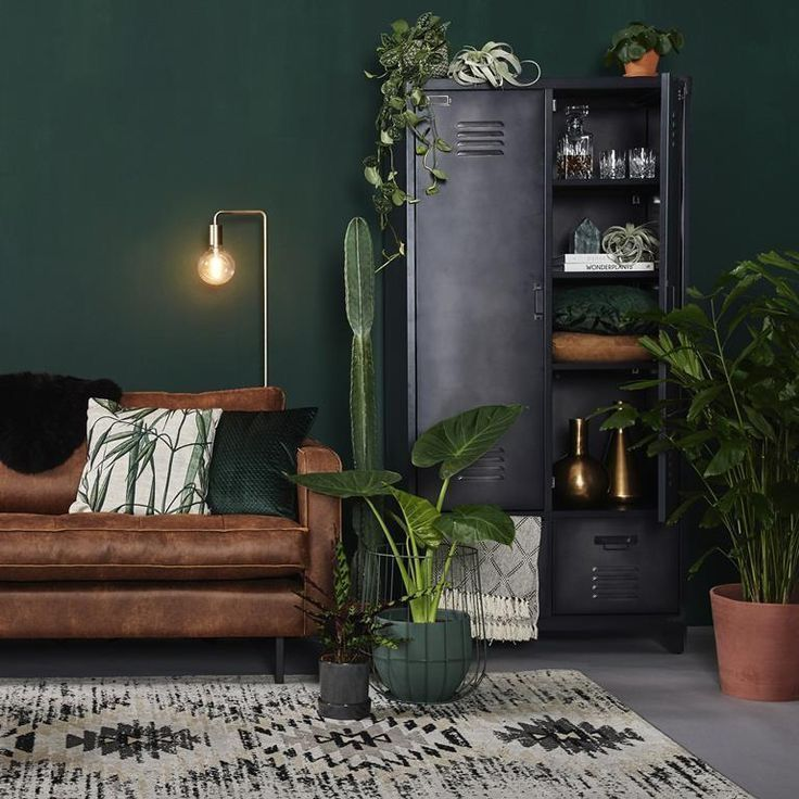 Brown Leather Sofa And The Rustic Cabinet Complements The Flawless Green Wall Beautifully G Living Room Green Interior Design Living Room Brown Living Room