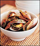 Large green-shelled mussels are farmed along the coast of New Zealand and exported around the world. The spicy aromatic broth that Auckland cookbook author Annabel Langbein uses here reflects the influence of New Zealand's growing Asian population on its cuisine.