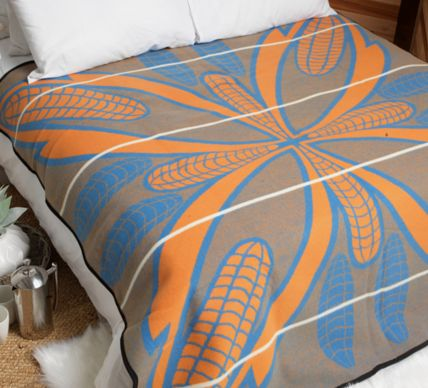 "Seana Marena Basotho Blanket. Considered the most prestigious of Basotho Blankets, the Seana Marena, ""Poone"" or ""mielie"" design shows cobs of corns. Corn, being synonymous with harvest and health, is used in the design to symbolize fertility and also wealth."