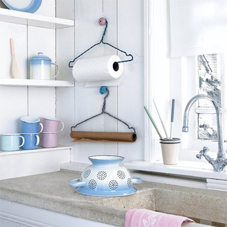 recycled coat hangers for kitchen organisation - Anyone who has clothes dry cleaned ends up with plenty of wire coat hangers. Love this idea for using metal coat hangers for paper towels and paper. - See more at: http://www.home-dzine.co.za/crafts/craft-recycled-kitchen.htm#sthash.PhT8JNrj.dpuf