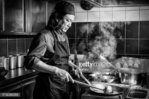Stock Photo : chinese man cooking in asian restaurant