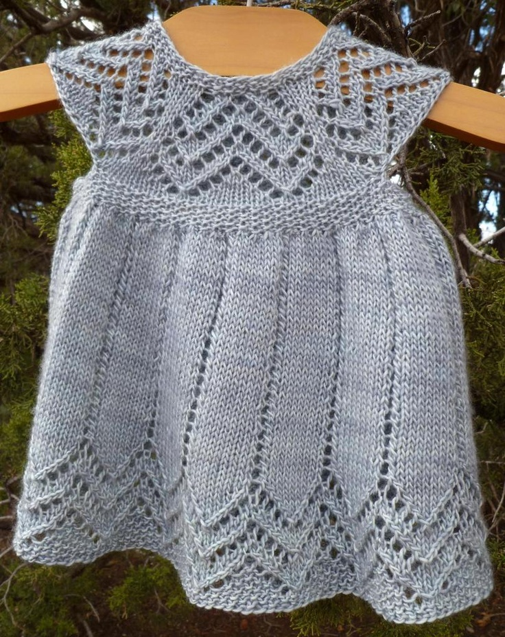 As your baby grows, this will grow from a dress to a tunic. Top down design with a pretty lace pattern on the yoke and skirt.