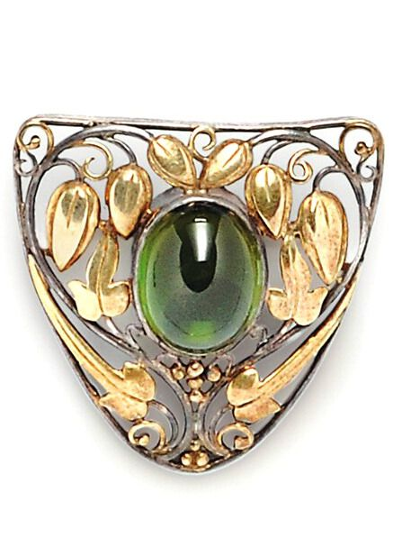Arts & Crafts Green Tourmaline Brooch, Frank Gardner Hale, the tourmaline cabochon set amongst gold and silver scrolling foliate devices, lg. 1 1/4 in., signed.