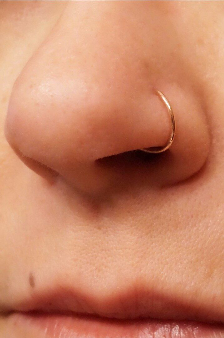 Rose Gold Nose Hoop Nose Ring 16G 18G 20G Rose Gold Nose Piercing by MidnightsMojo on Etsy https://www.etsy.com/listing/266940374/rose-gold-nose-hoop-nose-ring-16g-18g