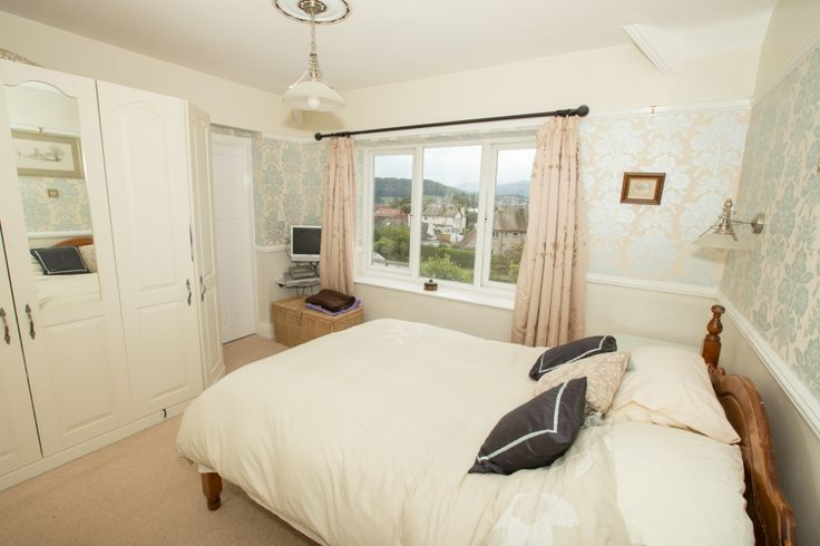 Master Bedroom with fitted wardrobes, access to ensuite bathroom, extensive views of Mountains and Conwy Castle