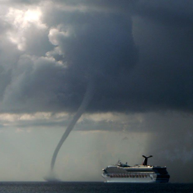 we spotted a waterspout similar to this while in the water with the Sting Rays in Grand Cayman, Cayman Islands.
