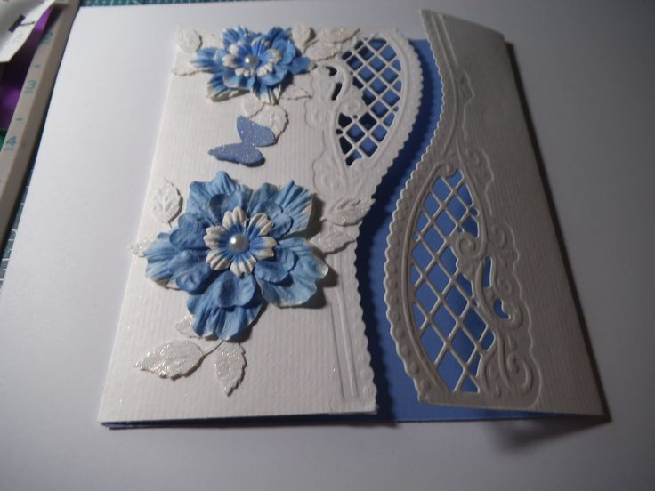 Made using Anja's edge die cut and handmade punch flowers coloured in copics.