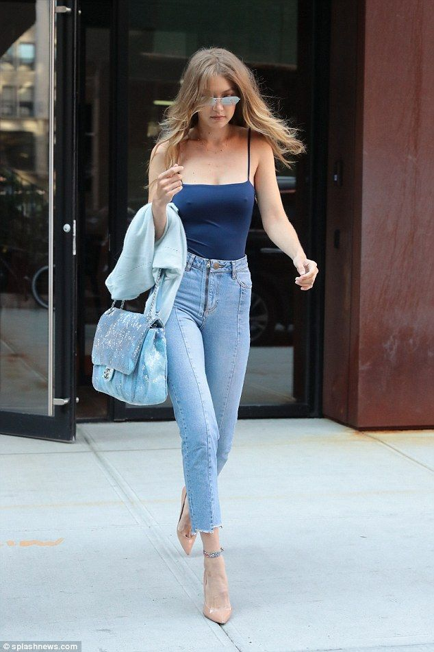 Gigi Hadid goes braless wearing a tight blue tank top in New York