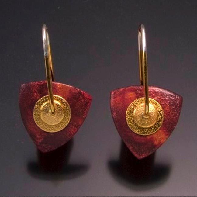 Keith Lewis creates copper finishes using a Japanese technique, heating the finished copper shape until brightly glowing, then plunge it into boiling water to achieve a plum red appearance.