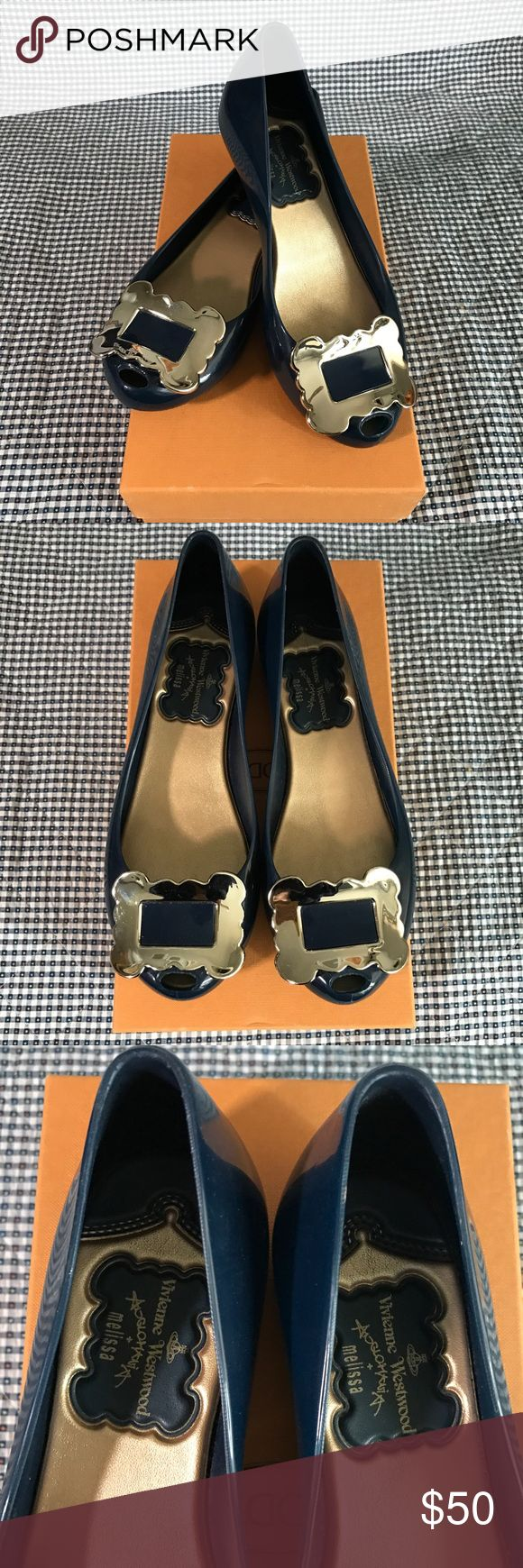 VIVIENNE WESTWOOD X MELISSA Jelly Flats (Navy) ✨Authentic✨This pair of Melissa Jelly Flats is designed by Vivienne Westwood. Definitely not your average flats! Very comfortable. With its unique buckle design, they are an attention-catcher 👀! SIZE: US 7 (true to size) CONDITION: Good! Signs of wear on the outer sole. This pair was purchased in London several years ago, no dust bag nor original box and tags. But guarantee authenticity! Vivienne Westwood Shoes Flats & Loafers