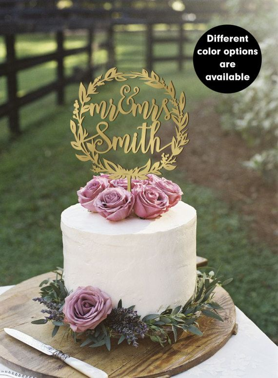Mr&Mrs wedding cake topper with your Surname in a wreath. A nice finishing touch to those beautiful wedding cake. Great quality of our toppers make it as a keepsake for all life to remind about your wedding day. Just add to the top of your cake and modify it immediately. Size and