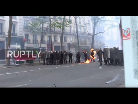France: Molotov cocktails strike police officers amid clashes at Paris protest - YouTube