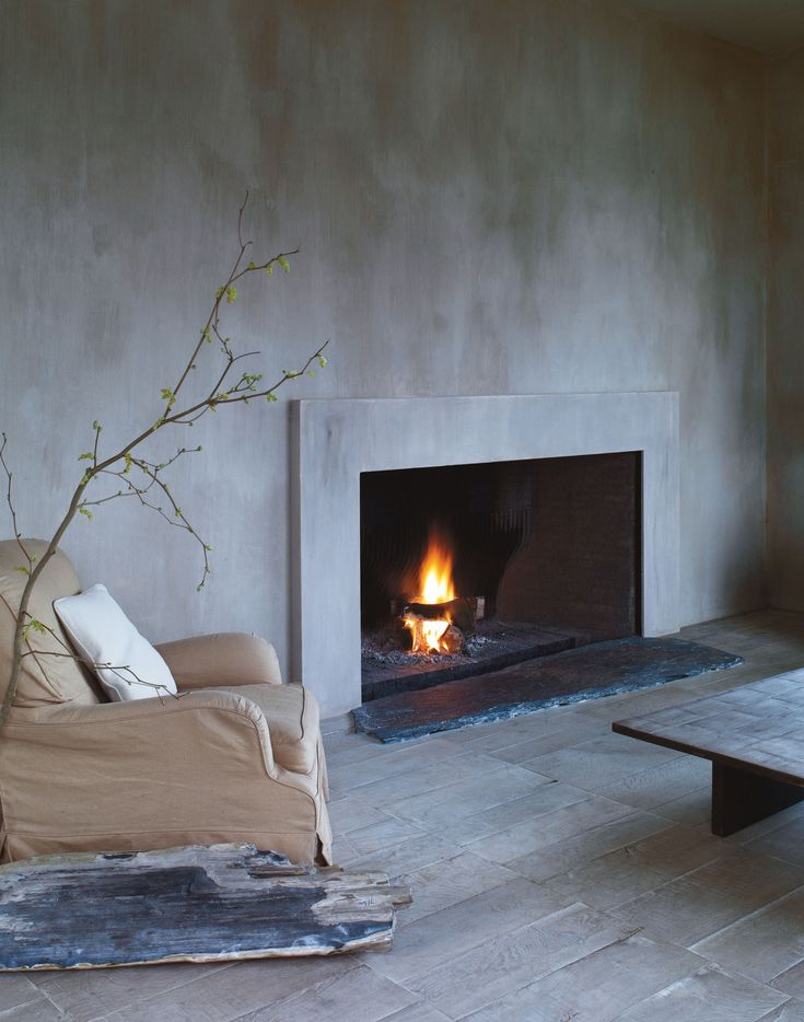 Axel Vervoordt: Wabi Inspirations... love the simplicity of this picture #walltextures #cement #fireplace