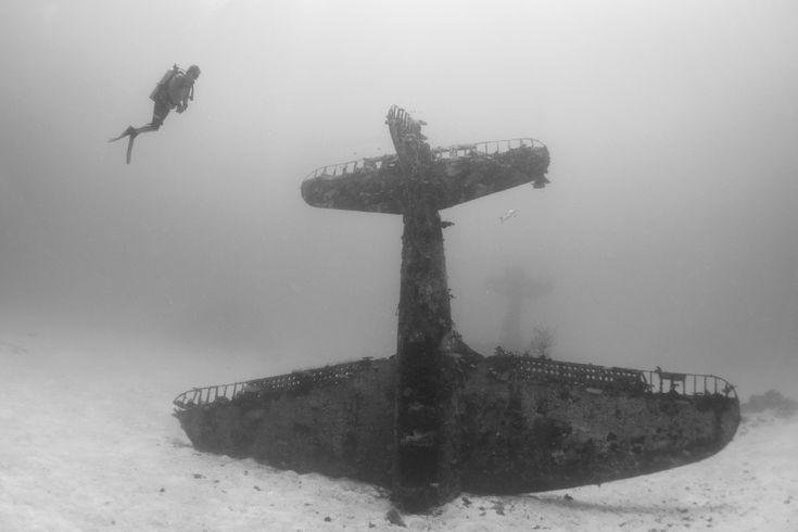 Underwater graveyard full of WWII planes is otherworldly  http://mashable.com/2015/07/18/underwater-plane-graveyard-wwii/