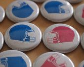 16 Gender Reveal Party Favors Sports Football Themed Baby Shower Pinback Buttons. $7.99, via Etsy.