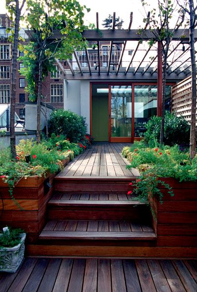"Sloped lot back deck - look at flush deck to house & planter ""walls"" integrated into steps. (Ipe deck and planters, mahogany pergola.) http://www.panix.com/~brooklyn/photos1.html#"